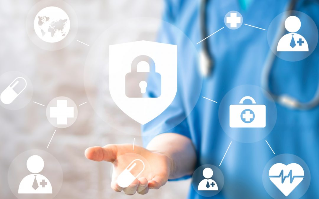 healthcare worked holding cybersecurity icons
